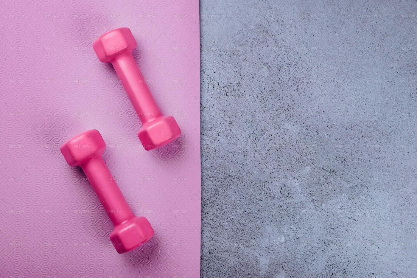 Sport Mat And Pink Dumbbells: Stock Photos