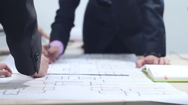 Male Architects Drawing Building Plan : Stock Video