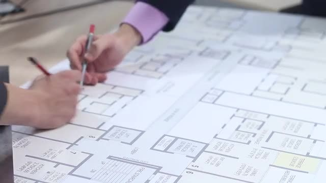 Architects Working On Building Plan : Stock Video