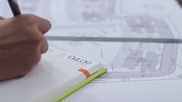 Engineer Makes Notes In The Drawings: Stock Video