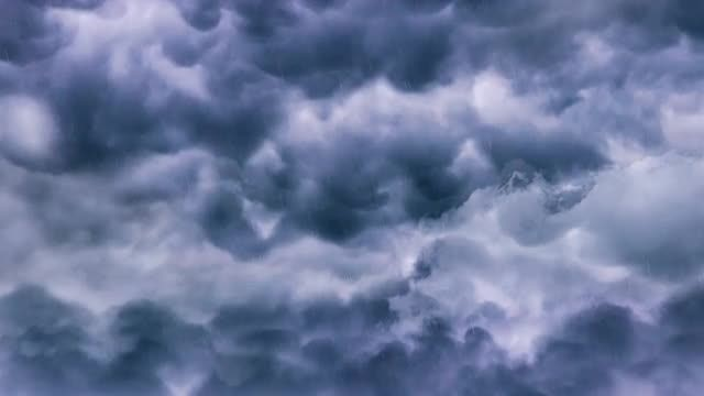 Flying Through Dark Rain Clouds: Stock Motion Graphics