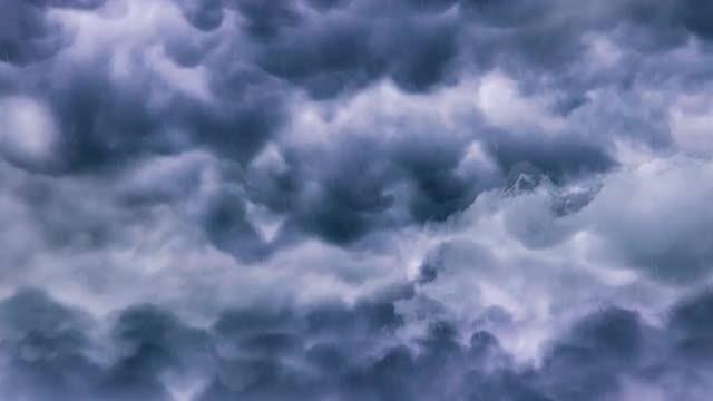 Flying Through Dark Rain Clouds: Stock Motion Graphics
