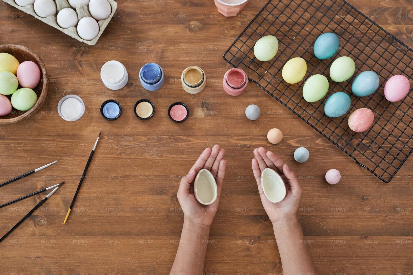 Holding Chocolate Eastern Eggs: Stock Photos