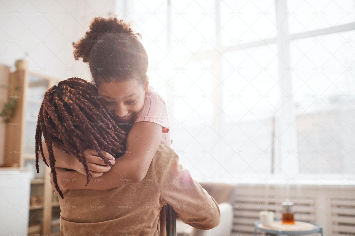 Girl Embracing Her Mom: Stock Photos