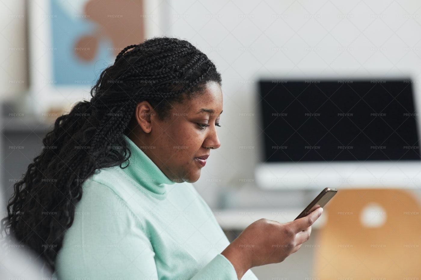 Woman Using Smartphone: Stock Photos