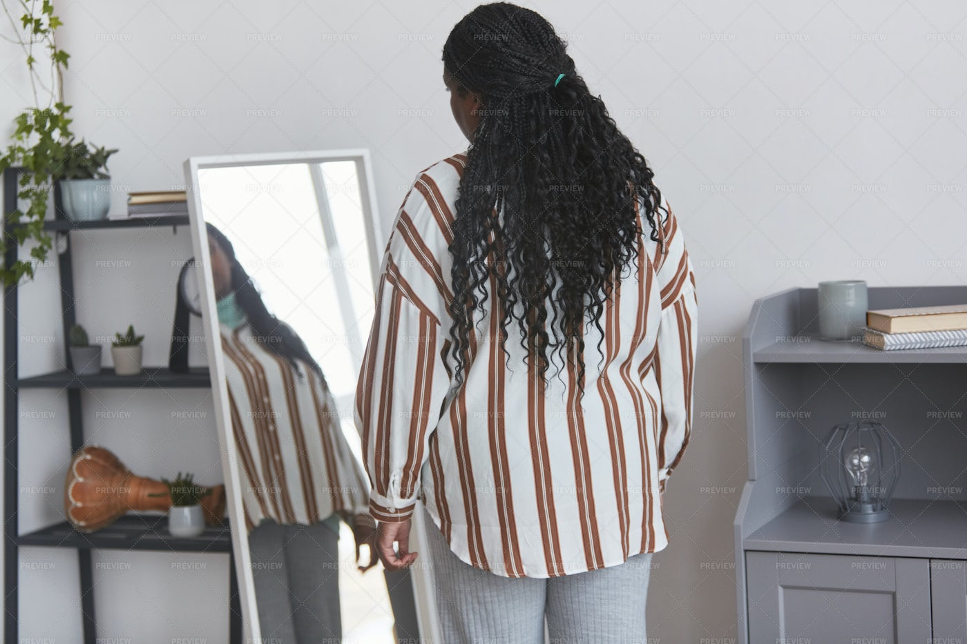 Woman Trying On Clothes At Home: Stock Photos