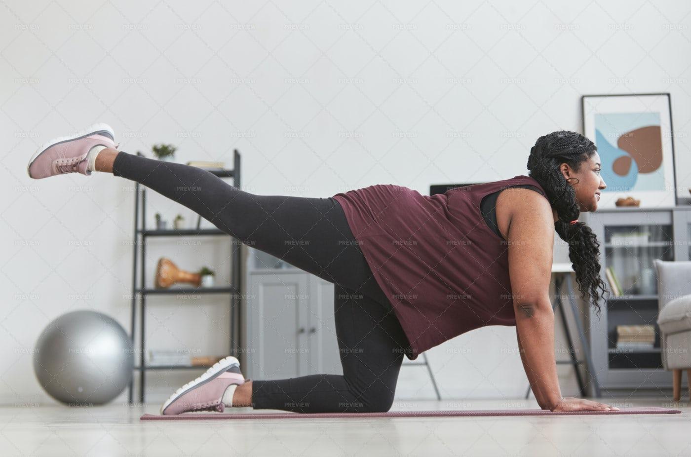Woman Stretching On Yoga Mat: Stock Photos