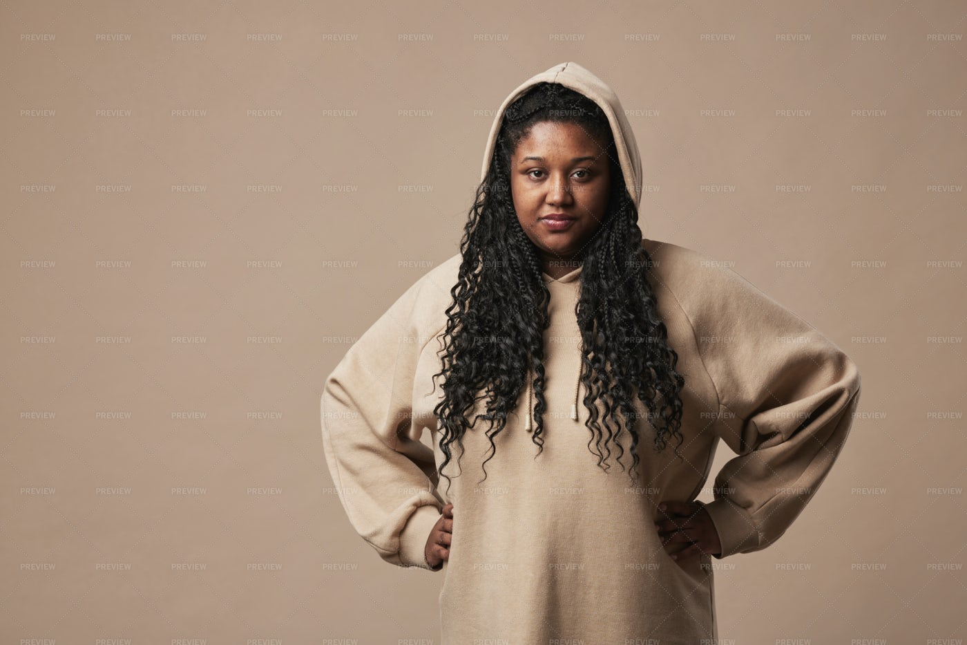 Confident Woman In Hoodie Portrait: Stock Photos