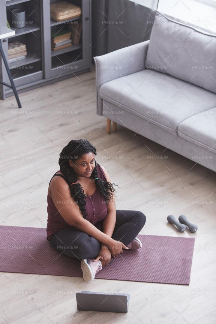Woman On Mat Exercising At Home: Stock Photos