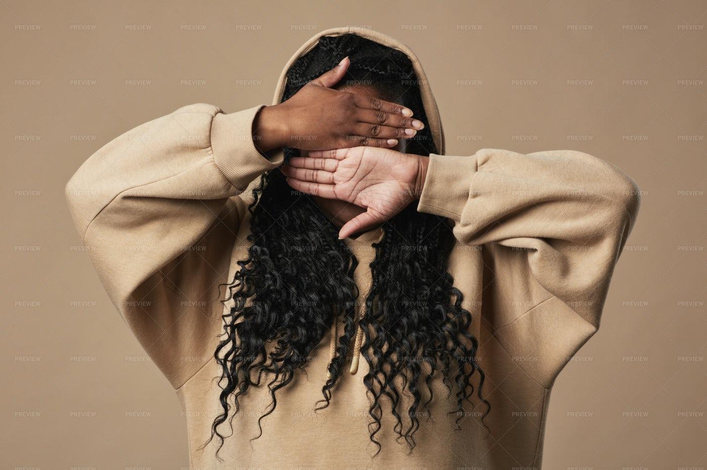 Woman In Tan Hoodie Hiding Face: Stock Photos