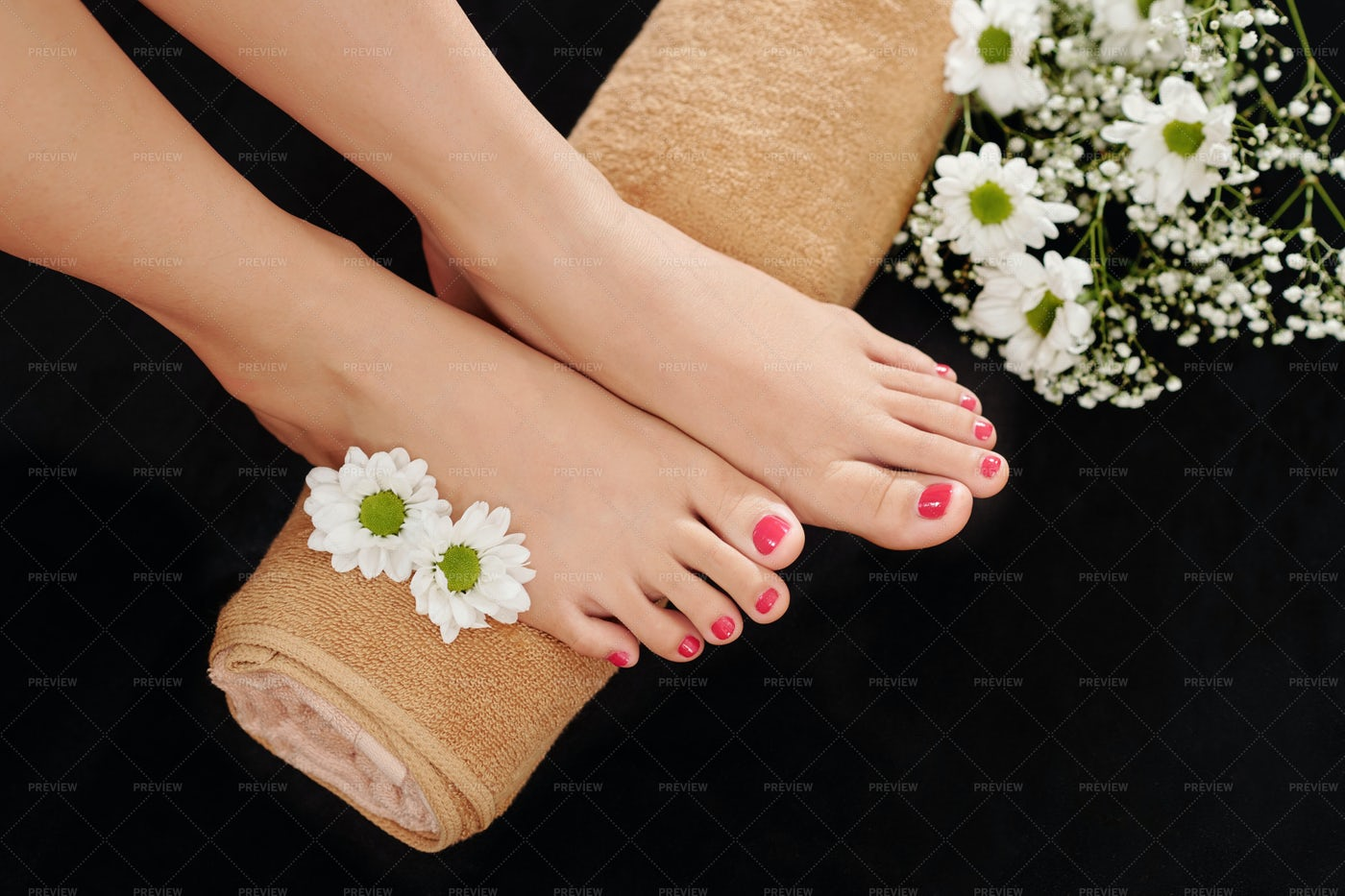 Manicured Feet On Rolled Towel: Stock Photos