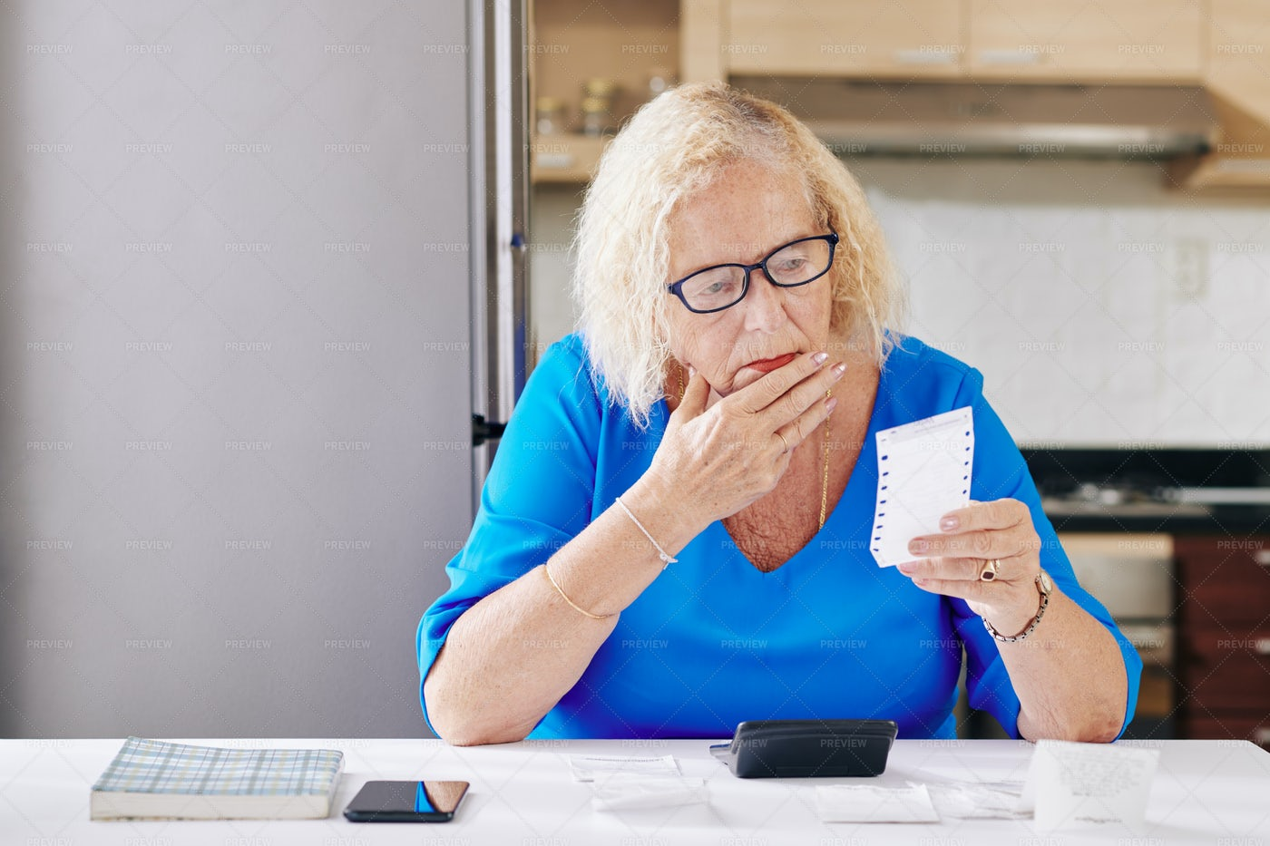 Woman Checking Bills: Stock Photos