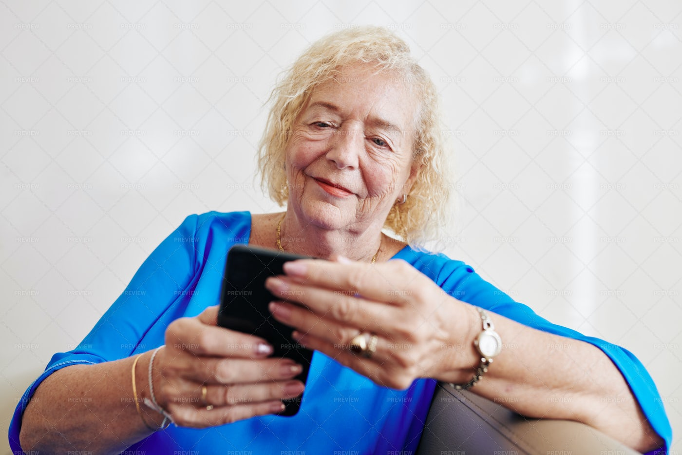 Senior Woman Reading Text Message: Stock Photos