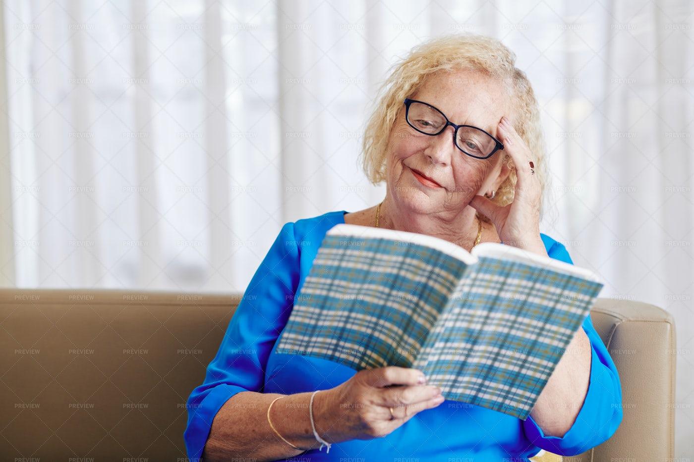 Senior Woman Reading A Novel: Stock Photos
