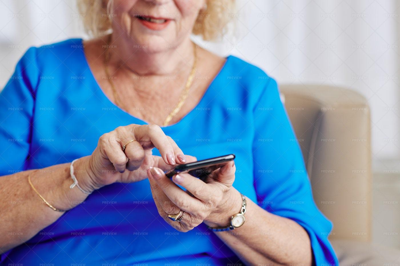 Senior Woman Dialing Phone Number: Stock Photos