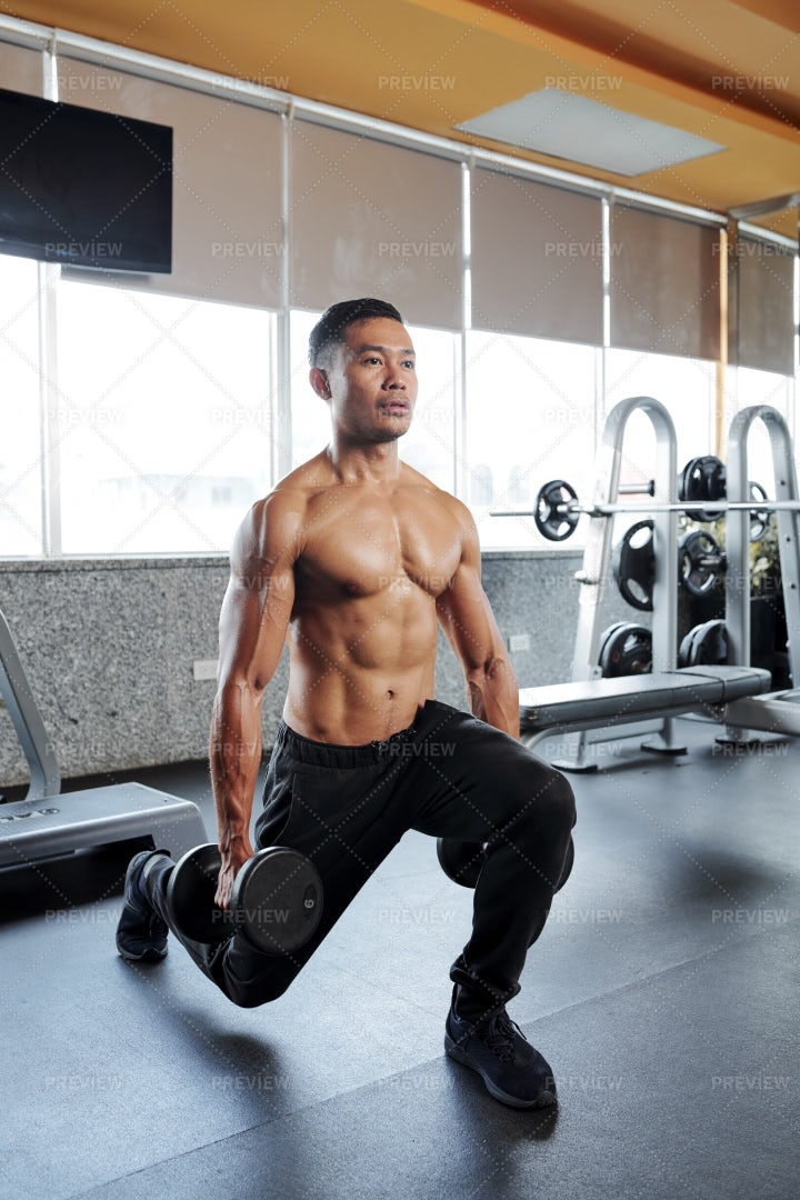 Man Concentrated On Doing Lunges: Stock Photos