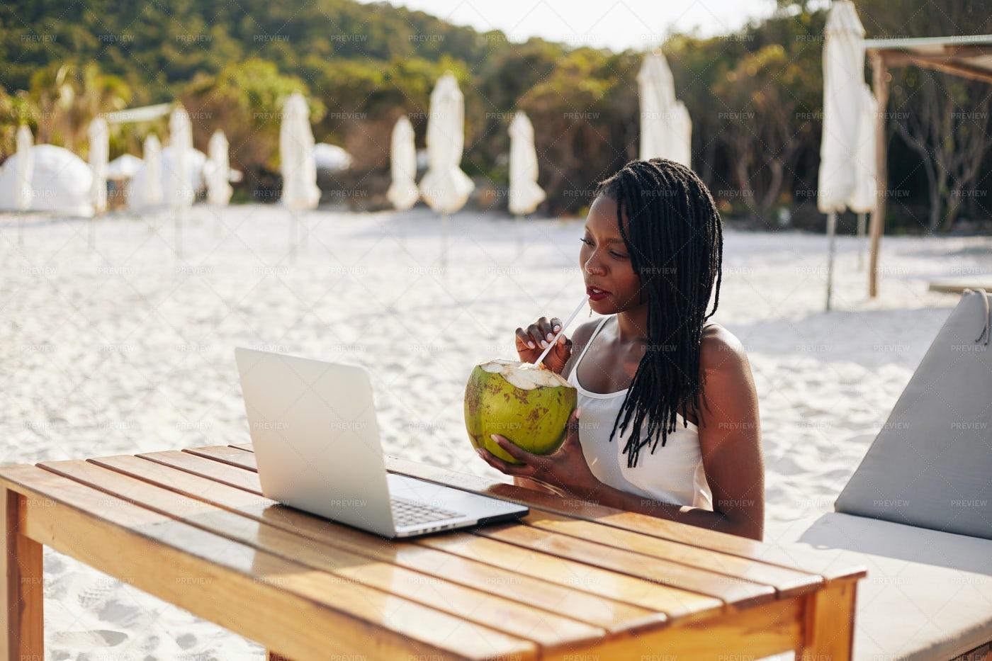Young Woman Using Laptop At Beach: Stock Photos