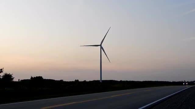 Wind Turbine By The Roadside: Stock Video
