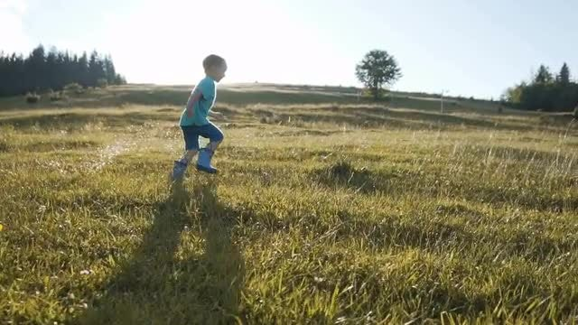 Boy Running Against Sundown: Stock Video