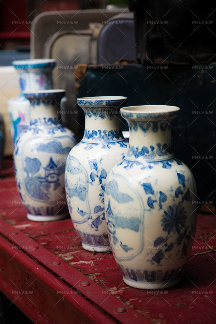 Antique Vases On Rustic Table: Stock Photos