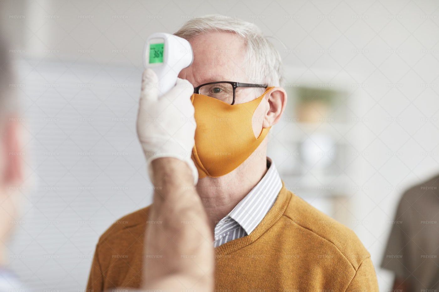 Senior Man At Safety Check In Clinic: Stock Photos