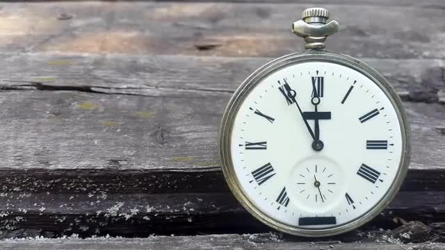 Timepiece On Old Wood: Stock Video