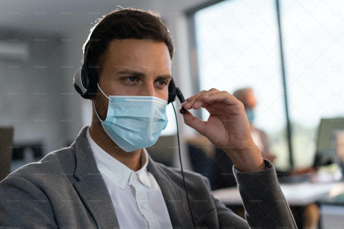 Call Center Agent During Pandemic: Stock Photos