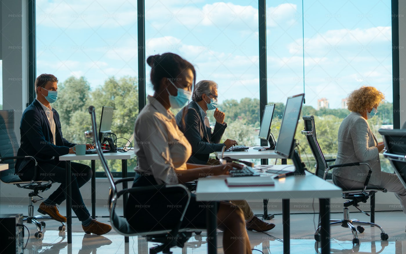 Office Atmosphere During COVID-19: Stock Photos
