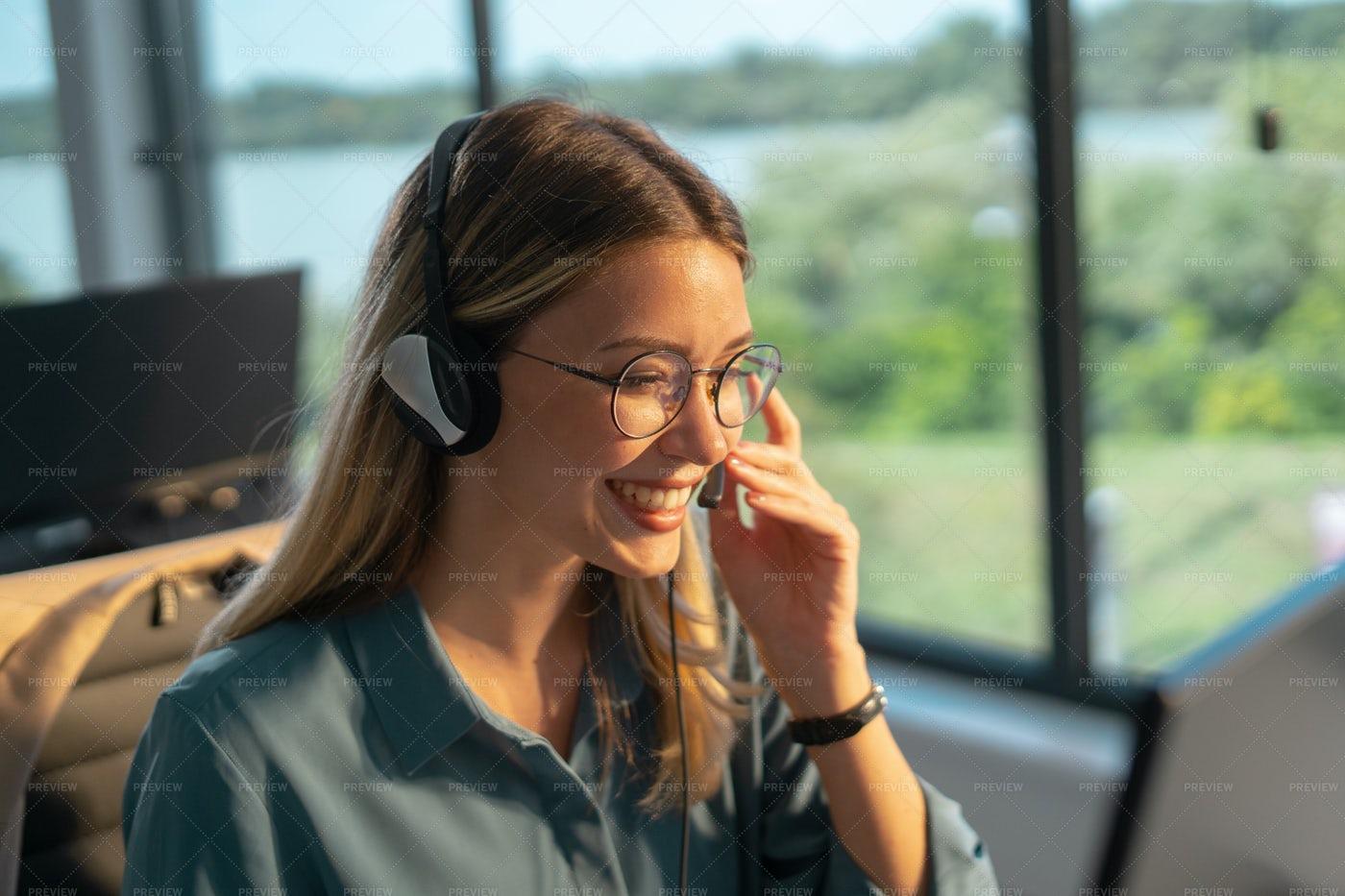 Smiling Call Center Agent: Stock Photos