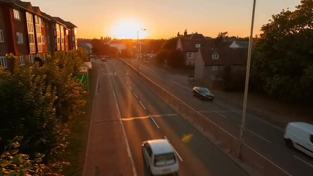 Traffic Flowing By Sunset: Stock Video