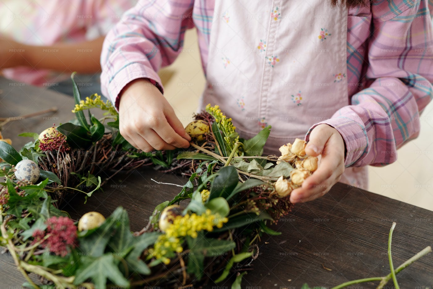 Hands Making Easter Wreath: Stock Photos
