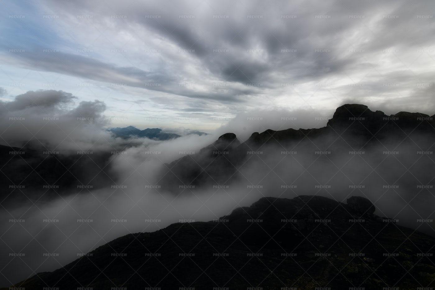 Clouds Between The Peaks: Stock Photos