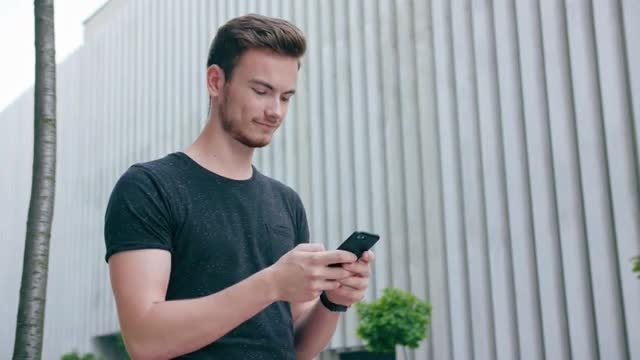 Man Reading Text On Smartphone: Stock Video