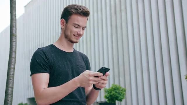 Young Guy Using A Smartphone: Stock Video
