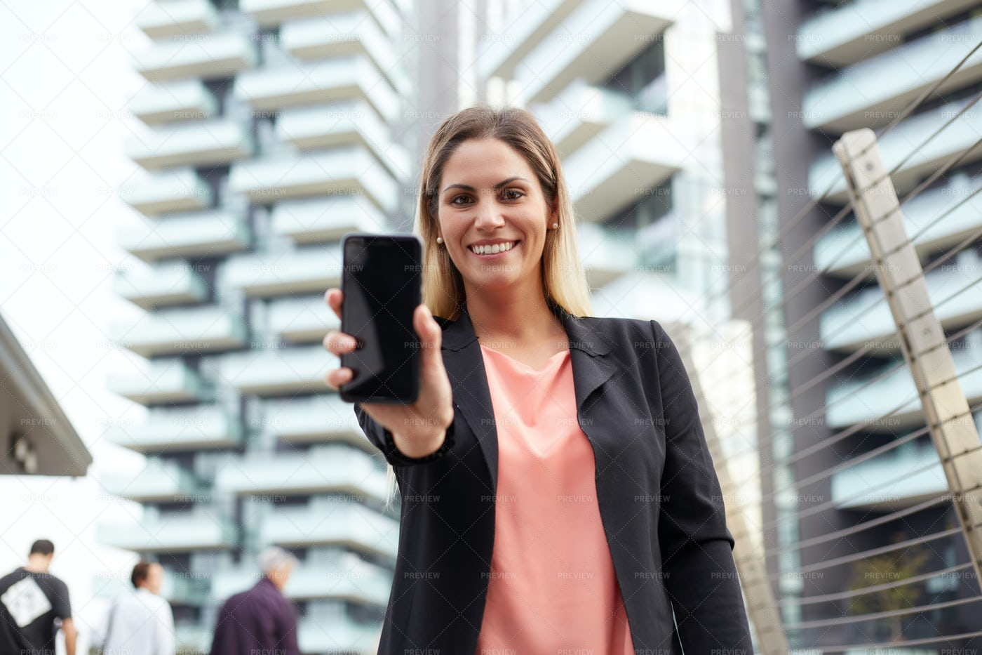 Businesswoman Showing Smartphone: Stock Photos