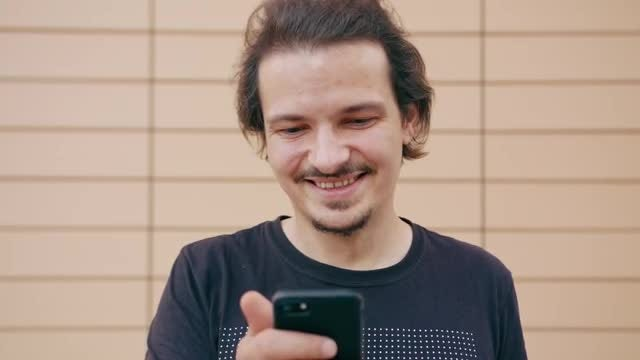Happy Man Using A Smartphone: Stock Video