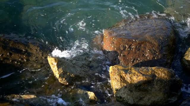 Ocean Waves Crashing Onto Rocks: Stock Video