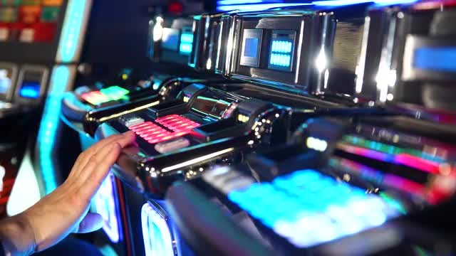 Man Playing A Slot Machine : Stock Video