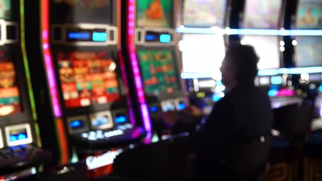 Anonymous Man Playing Slot Machine : Stock Video
