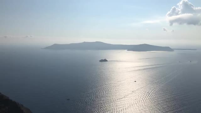 A Ship Near Santorini Island: Stock Video