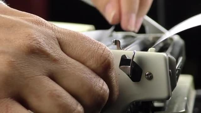 Adding Paper To A Typewriter: Stock Video