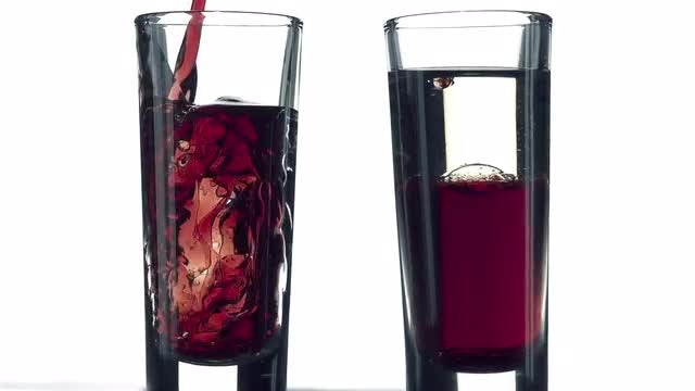 Liquid Beverage Poured Into Glass: Stock Video