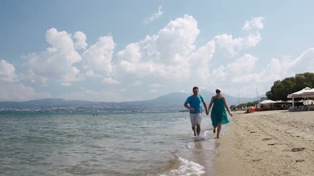 Young Couple Running On Beach: Stock Video