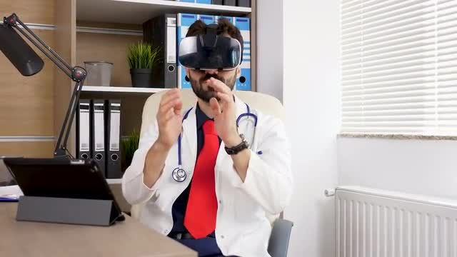 Male Doctor Using VR Headset: Stock Video