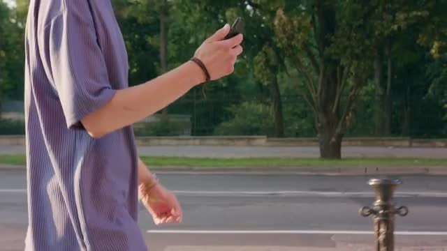 Man Using Smartphone While Walking: Stock Video