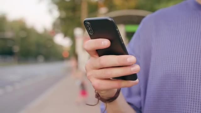 Man Using His Smartphone: Stock Video