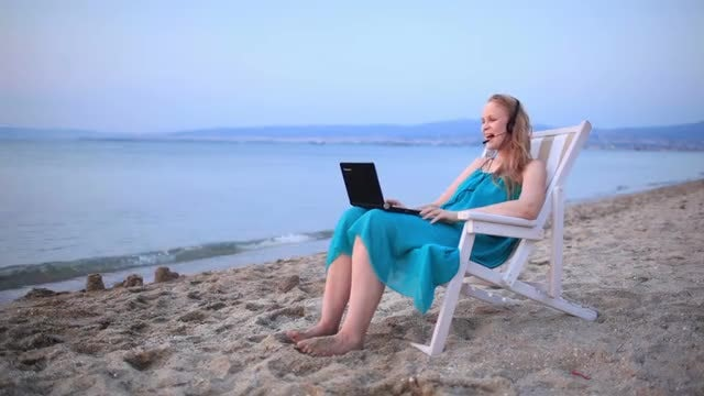 Woman Videocalling At The Beach: Stock Video