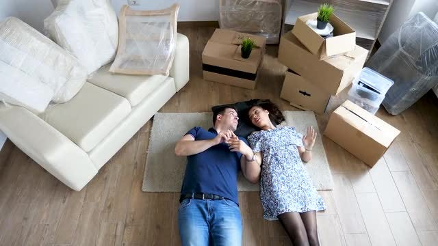 Couple Lying On The Floor: Stock Video