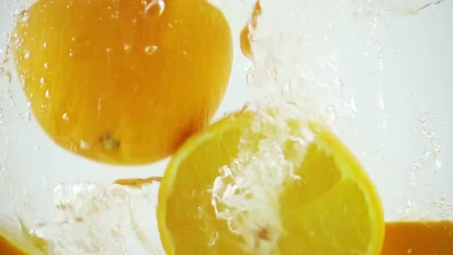 Oranges Floating On Water: Stock Video