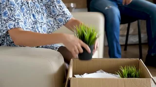 Man And Woman Unpacking Cartons: Stock Video